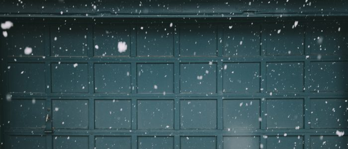 garage door with snow falling